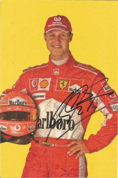 Michael Schumacher signed 8 x 6 colour photocard in Racing Overalls